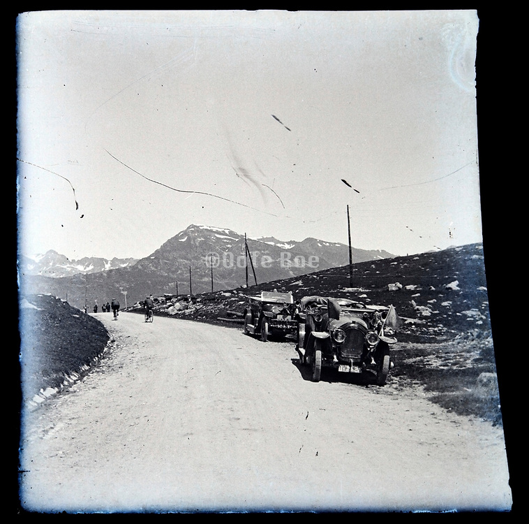 cars waiting at the mountain top during an early 1900s Tour de France stage