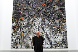"""© Licensed to London News Pictures. 14/11/2019. LONDON, UK. Anselm Kiefer next to his work """"Ramanujan Summation"""" 1/12, 2018-2019, at the preview of a new exhibition called """"Superstrings, Runes, The Norns, Gordian Knot"""" by Anselm Kiefer.  The works include large scale paintings and installations that draw on the scientific concept of string theory and are on display at the White Cube Gallery in Bermondsey 15 November to 26 January 2020.  Photo credit: Stephen Chung/LNP"""