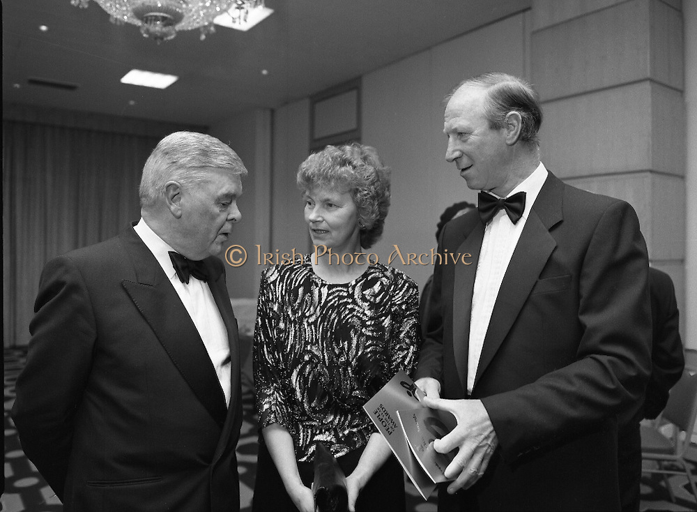 People Of The Year Awards.  (R91)..1988..22.11.1988..11.22.1988..22nd November 1988..This is the fourteenth year of the People of the Year Awards, sponsored by the New Ireland Assurance Company plc. The awards will be presented by Mr Ray Burke TD, Minister of Energy and Communications. Eight people have been nominated this year..Mr Ollie Jennings, for his contribution to community and cultural life of Galway City..Mr Jack Charlton, for restoration of pride to the Irish Soccer team..Ms Carmencita Hederman, For her efforts to instill a community spirit in Dublin..Maureen O'Mahony, for her dedication in assisting the sick and elderly in the Bantry area..Mr Tommy Boyle, for his contribution in having the Garda band ranked as one of the top bands in the world..Ms Alice Leahy, for a lifetime commitment in providing medical care to the Dublin Homeless..Ms Norma Smurfitt, for her voluntary contribution to the work of the Arthritis Foundation Of ireland..Mr Gordon Wilson, for his commitment to peace and reconcilliation in Northern Ireland...Image shows Mr Eoin Ryan, Chairman, New Ireland,Mrs Pat Charlton and Mr Jack Charlton at the awards ceremony.