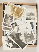box with various old family photographs