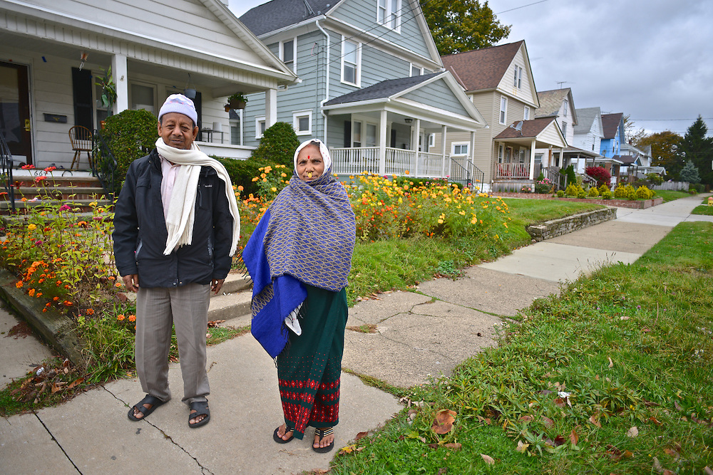Couple standing outside their home in North Hill.