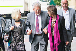 London, May 23rd 2014.  Celebrity entertainer Rolf Harris arrives at Southwark Crown Court in London with his daughter Bindi, left and his niece Jenny, as the case for the prosecution on 12 charges he faces of indecent assault against four girls aged between 7 and 19, is expected to conclude.