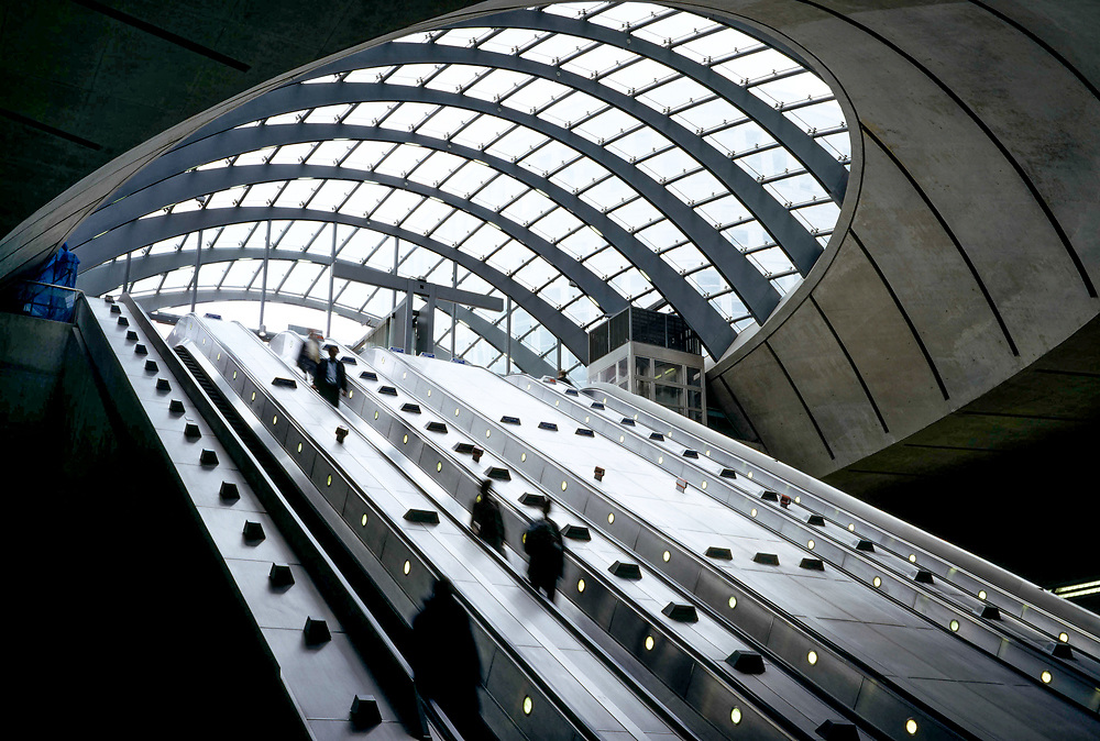 escalators at canary wharf's modern tube station