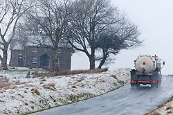 © Licensed to London News Pictures. 12/01/2017. Builth Wells, Powys, Wales, UK. A truckl drives through a wintry landscape on the high moorland of the Mynydd Epynt range near Builth Wells in Powys, Mid Wales, UK. Photo credit: Graham M. Lawrence/LNP