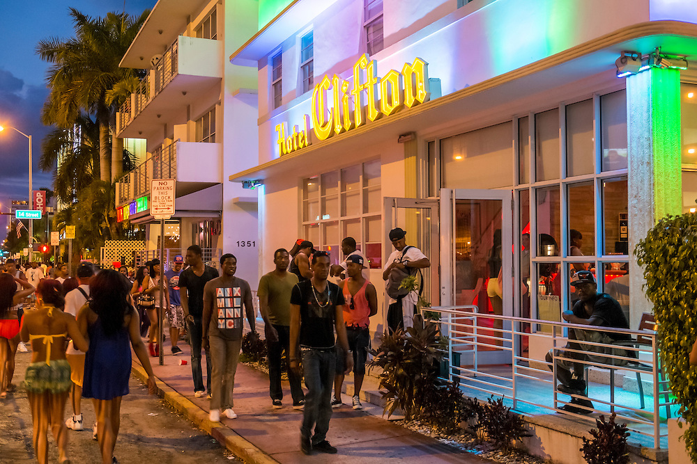 MIAMI BEACH - MAY 25: Out-of-towners walking in Collins Ave. at night during the Urban Beach Weekend, on May 25, 2013 in Miami Beach. This is the largest Urban Festival in the World, that caters towards the Hip Hop Generation. Over 300.000 participants make the annual trek to South Beach for 4 days full of fun, food, festivities, entertainment, music, and more.