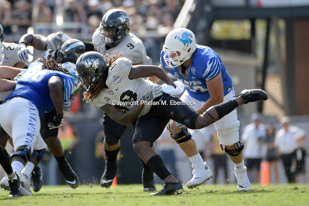 Central Florida linebacker Shaquem Griffin (18) pursues a play against Memphis during the first half of the American Athletic Conference championship NCAA college football game Saturday, Dec. 2, 2017, in Orlando, Fla. (Photo by Phelan M. Ebenhack)