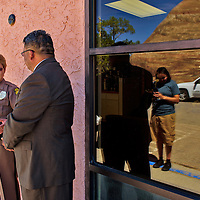 Chairperson of the Law & Order Committee Edmund Yazzie talks to Officer Gladys Antone after her daughter, Kansas Antone, was recgnized in the Council Chamber during the 23rd Navajo Nation Council Summer Session on Monday in Window Rock .