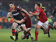 Jason Tovey of the Newport Gwent Dragons is tackled by Tommy O'Donnell & Ian Keatley of Munster .<br /> Guinness Pro12 rugby match, Munster v Newport Gwent Dragons at Thomond Park in Limerick , Ireland on Saturday 5th March 2016.<br /> pic by  John Halas, Andrew Orchard sports photography.