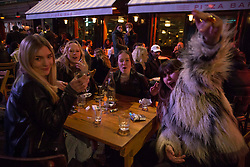 © Licensed to London News Pictures.  12/04/2021. London, UK. Members of the public are seen enjoying their drinks in Soho, central London as the government takes the next step on its lockdown-lifting road map and pubs and restaurants gardens  re-open today.  Photo credit: Marcin Nowak/LNP