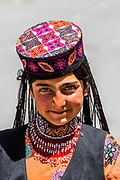 A young Tajik woman, Tashkurgan (means Stone Fortress in Uyghur), at 10,100 feet, along the Karakoram Highway. It was a caravan stop on the Silk Road and all routes of the Silk Road converged here to journey southward to Pakistan. It sits on the borders of both Afghanistan and Tajikistan, and is close to the border of Kyrgyzstan and Pakistan.  The majority population in the town are ethnic Mountain Tajiks. Xinjiang Province, China.