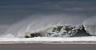 Crashing surf from tropical storm Wilma. Spindrift is the spray that is blown back from  the crest of a wave by an off-shore wind.