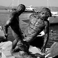 Bronze statue of fishermen in the harbour.<br />Bol, Brac, Croatia.