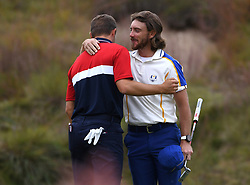 Team Europe's Tommy Fleetwood (right) and Team USA's Joseph Spieth hug after their singles match on the 18th green during day three of the 43rd Ryder Cup at Whistling Straits, Wisconsin. Picture date: Sunday September 26, 2021.