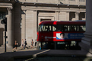 Advertising and passers-by outside the Bank of England during an unusual autumn heatwave on 13th September 2016, in the City of London, England.