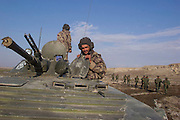 An Afghan crew from the Northern Alliance on board their BMP armoured personnel carrier.
