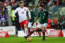 November 13, 2017 - Gdansk, Poland - Jakub Blaszczykowski (POL) vies Miguel Layun (MEX) during the International Friendly match between Poland and Mexico at Energa Stadium in Gdansk, Poland on November 13, 2017. (Credit Image: © Foto Olimpik/NurPhoto via ZUMA Press)