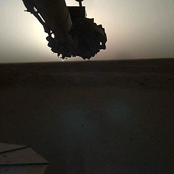 May 1, 2019 - Mars Surface - NASA's InSight lander used the Instrument Deployment Camera (IDC) on the end of its robotic arm to image this sunset on Mars on April 25, 2019, the 145th Martian day, or sol, of the mission. This was taken around 6:30 p.m. Mars local time. This color-corrected version more accurately shows the image as the human eye would see it. The first mission to send back such images was the Viking 1 lander, which captured a sunset on Aug. 21, 1976; Viking 2 captured a sunrise on June 14, 1978. Since then, both sunrises and sunsets have been recorded by the Spirit, Opportunity and Curiosity rovers, among other missions. (Credit Image: ? JPL-Caltech/NASA via ZUMA Wire/ZUMAPRESS.com)