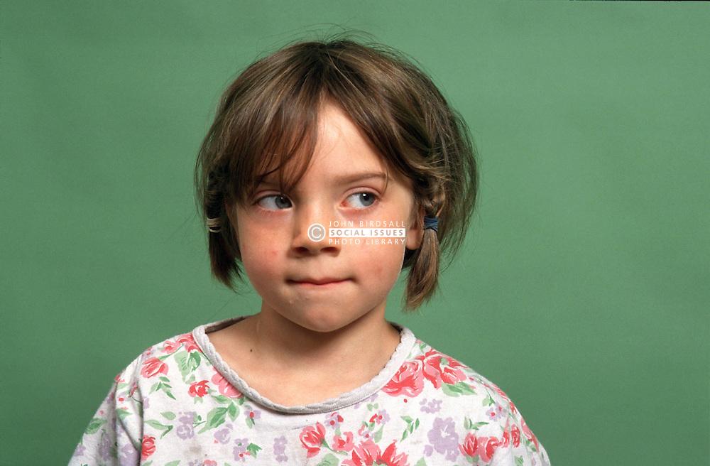 Portrait of young girl looking uncertain,