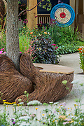 Blind Veterans UK: its all about Community Garden by Andrew Fisher Tomlin and Dan Bowyer - The Hampton Court Flower Show, organised by the Royal Horticultural Society (RHS). In the grounds of the Hampton Court Palace, London.