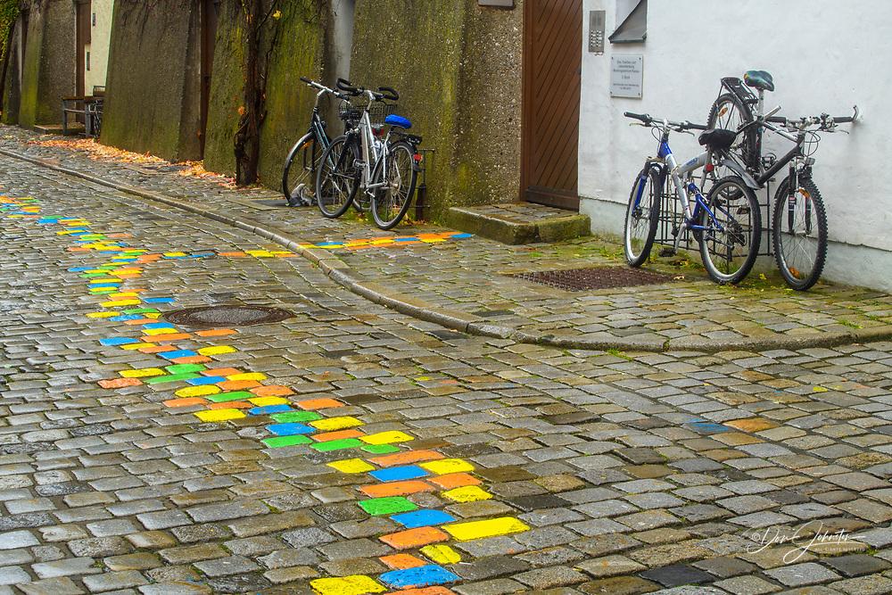 Painted cobblestones on the artist's walk, Passau, Bavaria, Germany