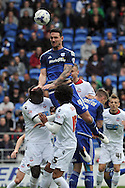 Cardiff City's Sean Morrison (4) rises highest to head there ball at goal. Skybet football league championship match, Cardiff city v Bolton Wanderers at the Cardiff city Stadium in Cardiff, South Wales on Saturday 23rd April 2016.<br /> pic by Carl Robertson, Andrew Orchard sports photography.