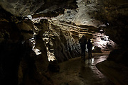 People walk through Dan yr Ogof Cave in the National Showcaves Centre for Wales on 21st February 2019 in Abercrave, Swansea, Wales, United Kingdom.  This is a 17-kilometer cave system in South Wales.