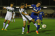 Plymouth Argyle striker Craig Tanner (27) and AFC Wimbledon defender Sean Kelly (22) tussle during the EFL Trophy match between AFC Wimbledon and Plymouth Argyle at the Cherry Red Records Stadium, Kingston, England on 4 October 2016. Photo by Stuart Butcher.