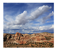 Petrified sand dunes and a muscular cloudscape in the Grand Staircase Escalante region of Utah, USA