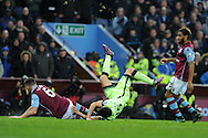 Jesus Navas of Manchester city is sent flying by a tackle from Ciaran Clark of Aston Villa. Barclays Premier league match, Aston Villa v Manchester city at Villa Park in Birmingham, Midlands  on Sunday 8th November 2015.<br /> pic by  Andrew Orchard, Andrew Orchard sports photography.