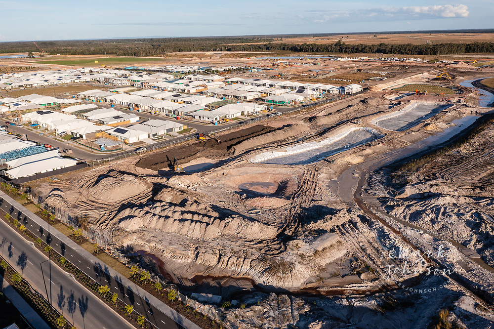 Aura, Caloundra, Australia-13 July 2021: More construction on Aura, a planned city in the foreground, with already built houses in the background, Caloundra, Sunshine Coast, Queensland, Austraila