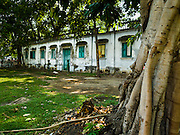 11 APRIL 2016 - BANGKOK, THAILAND:  The military barracks in Mahakan Fort now serve as homes for people who live in the community. The community is known for fireworks, fighting cocks and bird cages. Mahakan Fort was built in 1783 during the reign of Siamese King Rama I. It was one of 14 fortresses designed to protect Bangkok from foreign invaders, and only of two remaining, the others have been torn down. A community developed in the fort when people started building houses and moving into it during the reign of King Rama V (1868-1910). The land was expropriated by Bangkok city government in 1992, but the people living in the fort refused to move. In 2004 courts ruled against the residents and said the city could take the land. The final eviction notices were posted last week and the residents given until April 30 to move out. After that their homes, some of which are nearly 200 years old, will be destroyed.       PHOTO BY JACK KURTZ