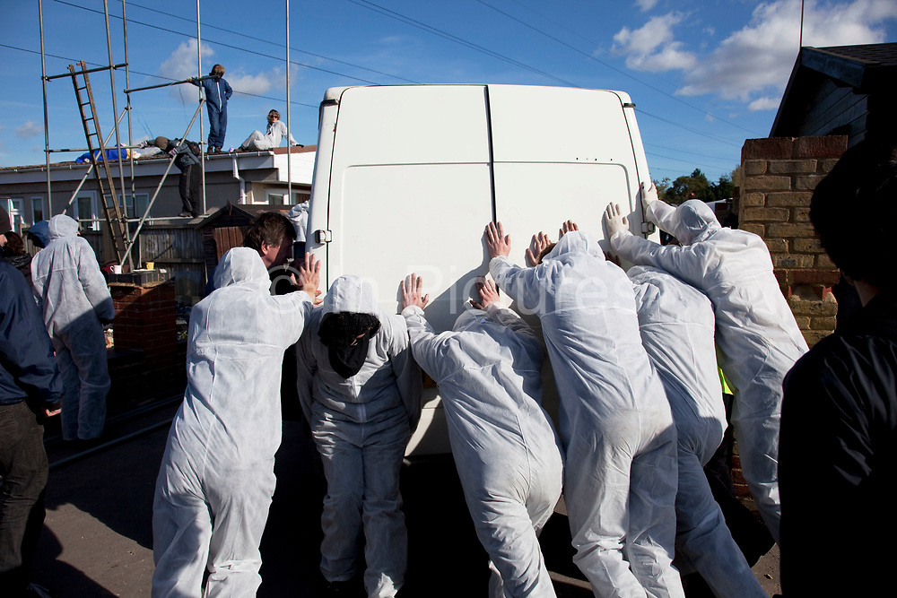 Protesters move a van. Travellers at Dale Farm site prior to eviction. Riot police and bailiffs were present on 20th October 2011, as the site was cleared of the last protesters chained to barricades. Dale Farm is part of a Romany Gypsy and Irish Traveller site in Crays Hill, Essex, UK<br /> <br /> Dale Farm housed over 1,000 people, the largest Traveller concentration in the UK. The whole of the site is owned by residents and is located within the Green Belt. It is in two parts: in one, residents constructed buildings with planning permission to do so; in the other, residents were refused planning permission due to the green belt policy, and built on the site anyway.