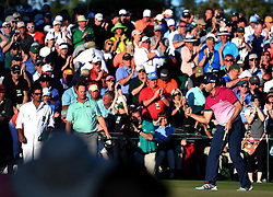 Sergio Garcia pumps his fist after sinking a putt on the 18th green during the third round of the Masters Tournament at Augusta National Golf Club in Augusta, Ga., on Saturday, April 8, 2017. Garcia finished the round tied for first with Justin Rose at 6-under. (Photo by Jeff Siner/Charlotte Observer/TNS) *** Please Use Credit from Credit Field ***