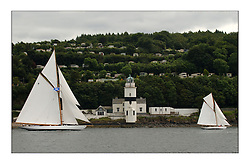 Moonbeam and Viola , two Gaff cutters passing the Cloch Lighthouse...This the largest gathering of classic yachts designed by William Fife returned to their birth place on the Clyde to participate in the 2nd Fife Regatta. 22 Yachts from around the world participated in the event which honoured the skills of Yacht Designer Wm Fife, and his yard in Fairlie, Scotland...FAO Picture Desk..Marc Turner / PFM Pictures