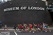 London, UK. Sunday 12th August 2012. Men's marathon competitors pass the Museum of London through the City of London, the last of the track and field competitions in the London 2012 Olympics.