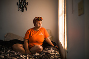 MONTGOMERY, AL – JUNE 11, 2019: Myra Powell, 21, sits in the apartment she rents with her fiancé, Stefvenie Buckner, in the Capitol Heights neighborhood. At age 19, while 26 weeks pregnant, Powell suffered a catastrophic placental abruption and was taken by ambulance to a nearby hospital. While there, doctors discovered her placenta had fully detached from the uterine wall, depriving her twin boys of oxygen. Silas and Stefvon died in utero. Narrowly escaping death herself, Powell would later be diagnosed with HELLP syndrome, a pregnancy-induced blood pressure condition in the eclampsia family that kills nearly a third of all women who develop it. As a young, poor, black woman from the south, Powell represents the deadliest cross-section of demographics among mothers in America, where more women die from pregnancy related causes than any other wealthy country in the world.