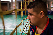 2016/06/02 – Bogotá, Colombia: Jonathan Fontes, 35, looks through a volleyball net during a training session at the High Performance Complex, Bogotá, 2nd June 2016. <br /> -<br /> Jonathan is a retired soldier of the Colombian army. In 2012, he stepped on an anti-personnel mine during a routine round in the Caqueta department, losing his right leg. At the beginning the process of recuperation was difficult, since he felt he was totally dependent on others. <br /> At first he started to focus on weightlifting sports, but found he was too tall. He was recommend to try seated volleyball, a sport that until then was unknown to him. Nowadays, he is the Captain of the Colombian team. The dream is to arrive to the Rio 2016 Paralympic games, but the national team only started to play the sport for the first time in 2011. <br /> The Colombian Volleyball net team finished 4th in the Pan-American Games of Toronto in 2015. Unfortunately they needed to have finished 2nd in order to qualify for a spot on this year Paralympics. Jonathan believes it still isn't the right time and that they have much more to learn. Instead they aim to work hard and be on the next Paralympics in Tokyo 2020. (Eduardo Leal)