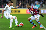 Swansea's Angel Rangel (l) challenges Aston Villa's Jordan Ayew (r). Barclays Premier league match, Swansea city v Aston Villa at the Liberty Stadium in Swansea, South Wales on Saturday 19th March 2016.<br /> pic by  Carl Robertson, Andrew Orchard sports photography.