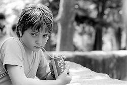 An unidentified boy sucks down a Coca-Cola at the Parc Zoologique de Paris in the Bois de Vincennes, Tuesday, June 10, 1984, in Paris. (Photo by D. Ross Cameron)