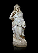 Roman statue of Selene. Marble. Perge. 2nd century AD. Inv no 2014/201. Antalya Archaeology Museum; Turkey.  Against a black background.<br /> <br /> Selene is the goddess of the moon. She is the daughter of the Titans Hyperion and Theia; and sister of the sun-god Helios; and Eos; goddess of the dawn. She drives her moon chariot across the heavens. .<br /> <br /> If you prefer to buy from our ALAMY STOCK LIBRARY page at https://www.alamy.com/portfolio/paul-williams-funkystock/greco-roman-sculptures.html . Type -    Antalya     - into LOWER SEARCH WITHIN GALLERY box - Refine search by adding a subject, place, background colour, museum etc.<br /> <br /> Visit our ROMAN WORLD PHOTO COLLECTIONS for more photos to download or buy as wall art prints https://funkystock.photoshelter.com/gallery-collection/The-Romans-Art-Artefacts-Antiquities-Historic-Sites-Pictures-Images/C0000r2uLJJo9_s0