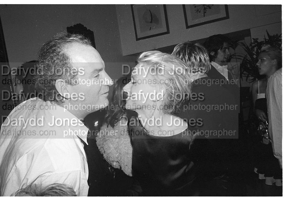 Charles Finch and Scarlett Johansson, Charles Finch pre-Bafta party. San Lorenzo. 15 February 2004. SUPPLIED FOR ONE-TIME USE ONLY> DO NOT ARCHIVE. ? Copyright Photograph by Dafydd Jones 66 Stockwell Park Rd. London SW9 0DA Tel 020 7733 0108 www.dafjones.com
