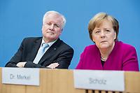 12 MAR 2018, BERLIN/GERMANY:<br /> Horst Seehofer (L), CSU, desig. Bundesinnenminister, Angela Merkel (R), CDU, Bundeskanzlerin, waehrend einer Pressekonferenz zum Koalitionsvertrag der CDU/CSU und SPD, Bundespressekonferenz<br /> IMAGE: 20180312-01-019