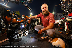 Artist Jeff Durrant working on his 1942 Harley-Davidson WLC bobber in a parking lot during the Cross Country Chase motorcycle endurance run from Sault Sainte Marie, MI to Key West, FL. (for vintage bikes from 1930-1948). Stage-6 from Chattanooga, TN to Macon, GA USA covered 258 miles. Wednesday, September 11, 2019. Photography ©2019 Michael Lichter.