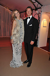 EVA HERZIGOVA and GREGORIO MARSIAJ at the Raisa Gorbachev Foundation Gala held at the Stud House, Hampton Court, Surrey on 22nd September 22 2011