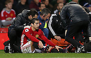 Henrikh Mkhitaryan of Manchester United waits to go off injured in a stretcher during the English Premier League match at Old Trafford Stadium, Manchester. Picture date: December 11th, 2016. Pic Simon Bellis/Sportimage
