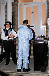 © licensed to London News Pictures. 29/06/2011. London, UK. Police forensics at the scene where dismembered human body part, believed to be a head, was found in a West London garden last night (28/06/2011). Officers search the basement of a property in West Kensington where the body part was believed to have been found. See special instructions . Photo credit should read Cliff Hide/LNP