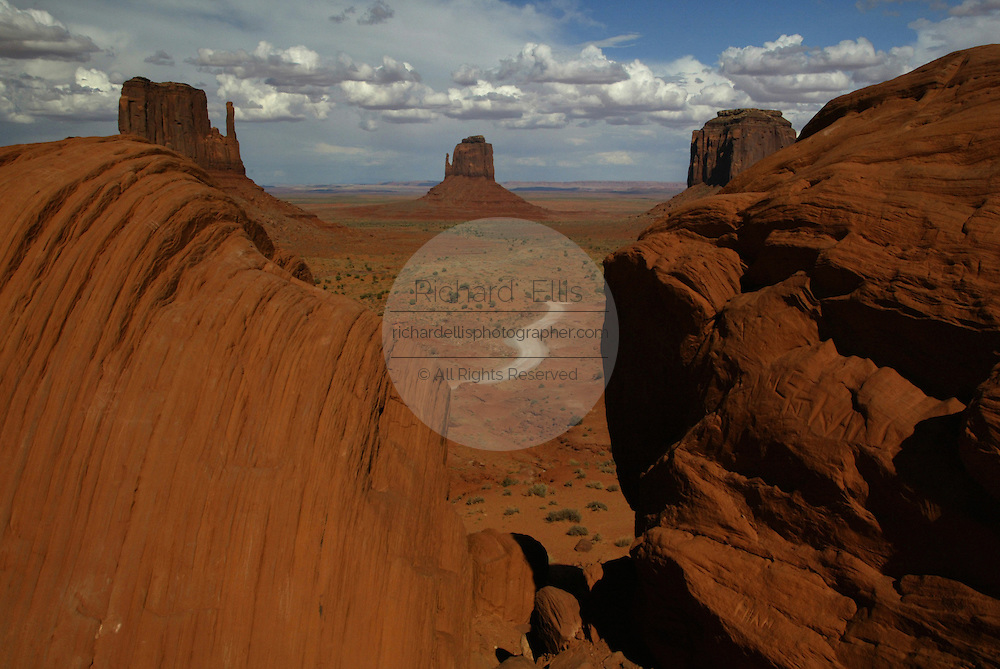 View of the Mittens in Monument Valley on the southern border of Utah with northern Arizona. The valley lies within the range of the Navajo Nation Reservation. The Navajo name for the valley is Tsé Bii' Ndzisgaii - Valley of the Rocks.