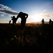 Photographers shoot sunrise over Grand Teton in Moose, Wyoming.