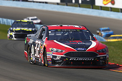 August 5, 2018 - Watkins Glen, New York, United States of America - Matt DiBenedetto (32) brings his car through the turns during the Go Bowling at The Glen at Watkins Glen International in Watkins Glen , New York. (Credit Image: © Chris Owens Asp Inc/ASP via ZUMA Wire)