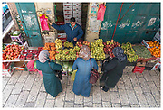Ladies shop for fruit next to Herod's Gate in the Old City of Jerusalem